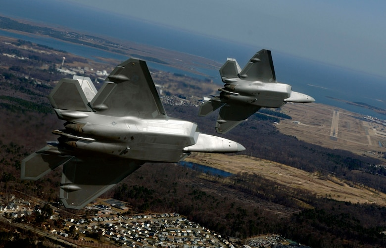 Lt. Col. Dirk Smith and Maj. Kevin Dolata turn on final approach to Langley Air Force Base, Va., Friday, March 3, 2006 to deliver the first F-22A Raptors assigned to the 94th Fighter Squadron.  The 94th is the second squadron at Langley to receive the new stealth fighter. (U.S. Air Force photo/Tech. Sgt. Ben Bloker)