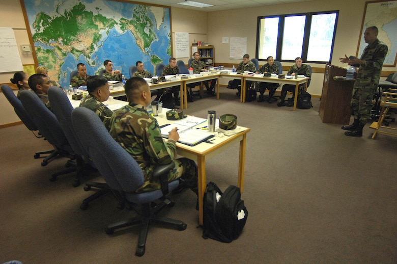 HICKAM AIR FORCE BASE, Hawaii -- Master Sgt. Todd Joiner lectures on enlisted feedback during an Airman Leadership School class Tuesday, March 7, 2006, at Hickam Air Force Base, Hawaii. This class marks the first time Philippine Air Force students are attending the course. They will take back the lessons learned and develop their own leadership course within the Philippine Air Force. Sergeant Joiner is an instructor at the Hickam Professional Military Education Center.