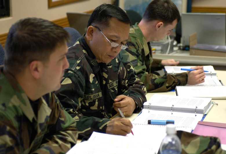 HICKAM AIR FORCE BASE, Hawaii -- Command Sgt. Maj. of the Philippine Air Force Cesar Soloria takes notes during Airman Leadership School class, Tuesday, March 7, 2006, at Hickam Air Force Base, Hawaii. The command sergeant major and four other students are the first Philippine Air Force Airmen to attend the class. They will take back the lessons learned and develop their own course within their air force.