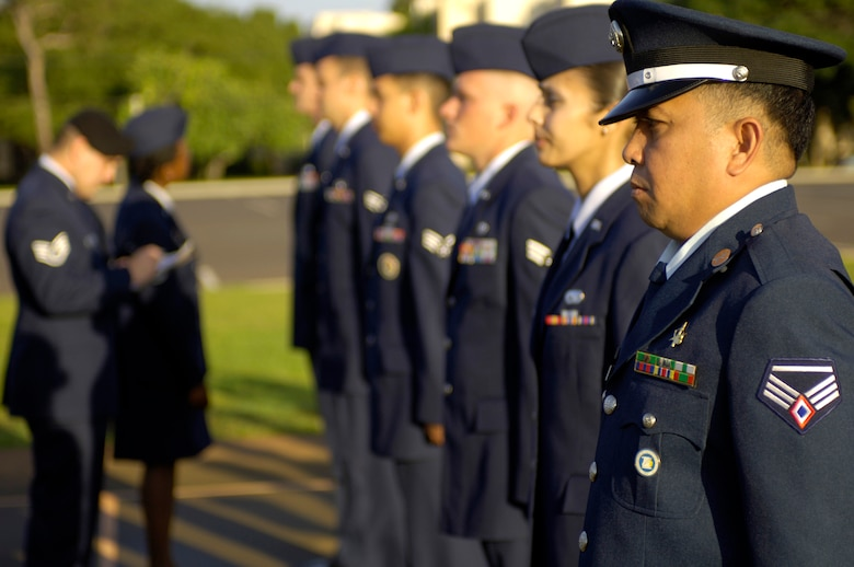 HICKAM AIR FORCE BASE, Hawaii -- Staff Sgt. Noel Alarcon from the Philippine Air Force stands at attention for an open ranks inspection during Airman Leadership School class Wednesday, March 8, 2006, at Hickam Air Force Base, Hawaii. Sergeant Alarcon and four other Philippine Air Force students are the first Airmen from their service to attend the class. They will take back the lessons learned and develop their own leadership course within their air force.