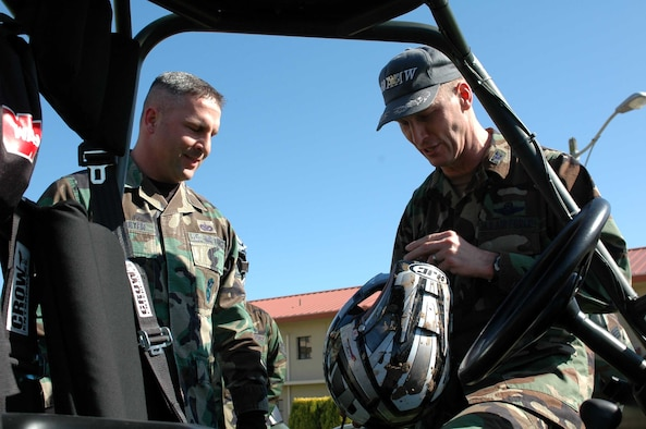 Col. Timothy Zadalis, 60th Air Mobility Wing acting commander, takes the safety of Travis Airmen personally as he checks the helmet of Staff Sgt. Jon Baumeyer, 60th Security Forces police services NCOIC.  (U.S. Air Force photo by Staff Sgt. Matt McGovern)