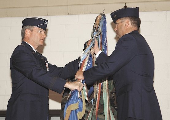 CANNON AIR FORCE BASE, N.M. -- Lt. Gen. Randall Schmidt, 12th Air Force commander, presents Col. Scott West the 27th Fighter Wing guidon in a change of command ceremony Monday in Hangar 208. Colonel West is the former vice commander of the 52nd Fighter Wing at Spangdahlem Air Base, Germany and is a command pilot with more than 2,400 flying hours.