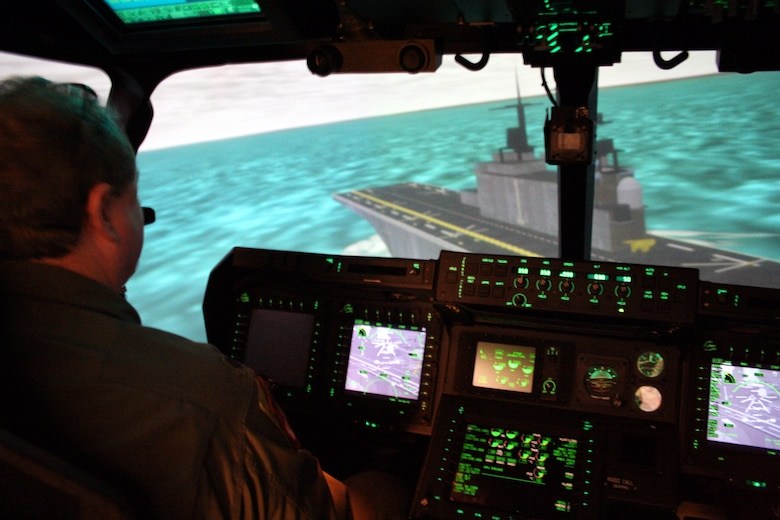 Lt.Col. Jonathan Jay, CV-22 program manager, lines up for landing on an aircraft carrier in the CV-22 simulator.