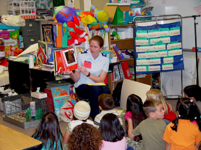 TORRANCE, Calif. -- Capt. Mary Danner, Air Force Public Affairs Entertainment Liaison Office, reads Duck on a Bike to a class at Carr Elementary School here March 2. The captain was among approximately 30 Airmen reading to elementary students during the Read Across America event held in local schools.