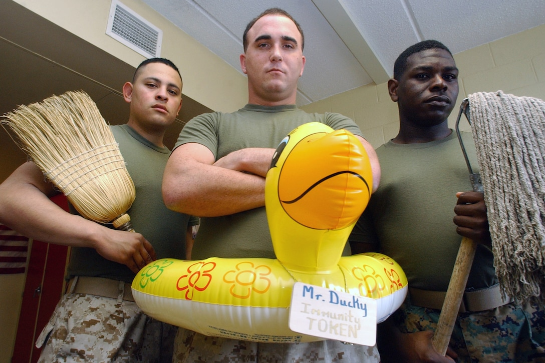 MARINE CORPS BASE CAMP LEJEUNE, N.C. – Lance Cpl. Marco Martinez, Pfc. Craig Mittendorf and Lance Cpl. Bernard Simmons, three legal service specialists with Company A, Headquarters and Support Battalion, Marine Corps Base, were the first Marines ever to be awarded Mr. Ducky. After each week's field day inspection, Mr. Ducky is awarded to the Marines of Alpha Company with the cleanest room. In recognition of their hard work and dedication, the winners are excused from the following week's inspection.::n::Photo by:  Lance Cpl. Adam Johnston