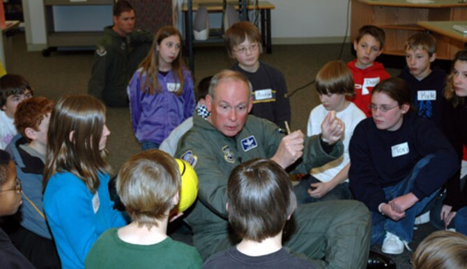 COLORADO SPRINGS, Colo. -- General Lance W. Lord, Commander of Air Force Space Command, teaches sixth grade students a lesson on space during the launch of the High Frontier Adventures program here Feb. 10. The general kicked off High Frontier Adventures at school District 20s Discovery Canyon Campus. High Frontier Adventures is a space professional outreach program that aims to improve students interest in studying math, science, technology and engineering through exposure to space.