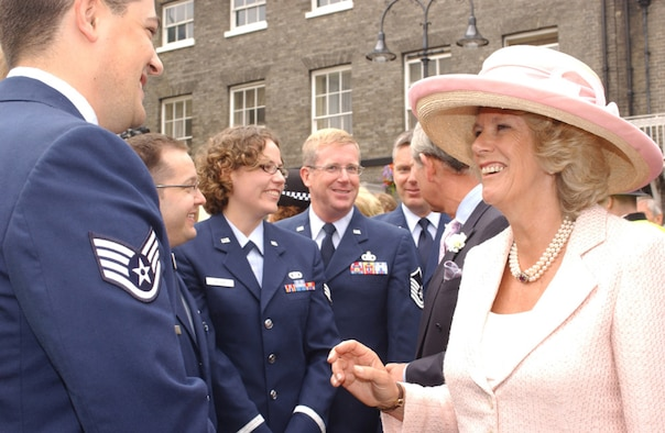 ROYAL AIR FORCE MILDENHALL, England (USAFENS) -- The members of the U.S. Air Forces in Europe Band's Brass Quintet met the Prince of Wales and the Duchess of Cornwall after the official ceremony for the completion of the Millennium Tower Project at St. Edmundsbury Cathedral in Bury St. Edmunds, England, July 22. The Brass Quintet performed, at the invitation of the Very Reverend Dean Atwell, Dean of St. Edmundsbury Cathedral, on Angel Hill outside the cathedral and in the historic Abbey gardens during the celebrations. (Photo by Staff Sgt. Valerie Smith)
