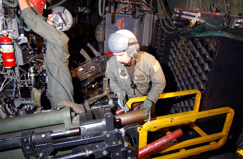 Aerial gunners from the 4th Special Operations Squadron, load a 105 mm Howitzer cannon aboard an AC-130U gunship.