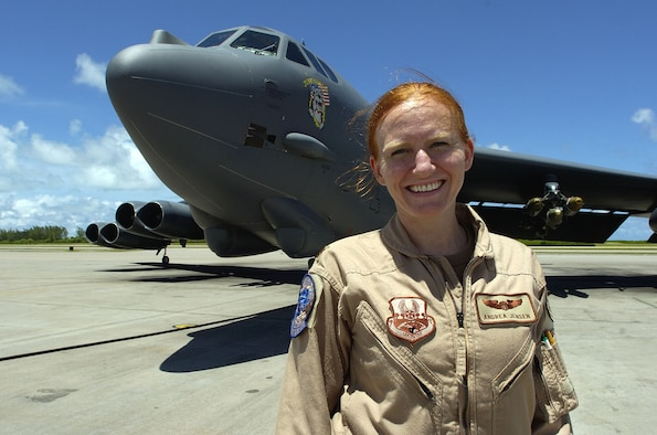 Maj. Andrea Jensen, 40th Expeditionary Group B-52 pilot, stands in front of a B-52 Stratofortress. Major Jensen has accumulated 100 combat flying hours providing close-air support for forces on the ground in Afghanistan. (U.S. Air Force photo/Senior Master Sgt. John Rohrer)