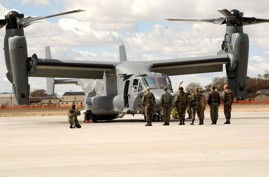 Airmen at Kirtland AFB, N.M., prepare to greet Lt. Gen. Michael W. Wooley, commander of the Air Force Special Operations Command.  General Wooley delivered the Air Force's first operational CV-22 Osprey to the 58th Special Operations Wing Monday, March 20, 2006. (U.S. Air Force photo/Staff Sgt. Markus Maier)