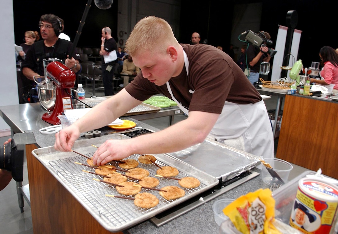 Senior Airman David Sutherland prepares his snickerdoodle pop cookies to compete against four others during the 2006 Food Network Cookie Challenge Monday, March 20 in Denver.  Airman Sutherland is a missile chef with the 741st Missile Squadron, Minot Air Force Base, N.D. (U.S. Air Force photo/Senior Airman Taylor Marr)