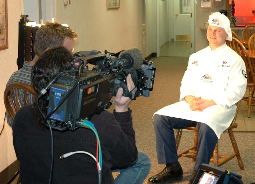 Senior Airman David Sutherland interviews with producer Dean Pedersen and cameraman Gary Feblowitz at I-01 missile alert facility Wednesday, March 15, 2006, as part of  a profile for the Food Network Challenge series.  The Airman competed against four others in the network's cookie challenge March 20 in Denver.  Airman Sutherland is a missile chef with the 741st Missile Squadron, Minot Air Force Base, N.D.  (U.S. Air Force photo/Maj. Dani Johnson)