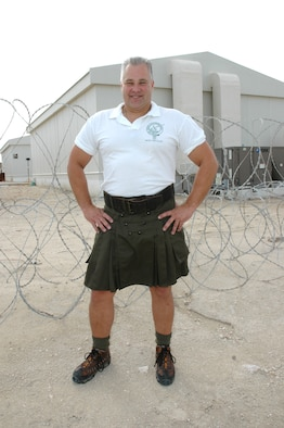 """Sporting his kilt in Southwest Asia, Senior Master Sgt. Todd Flickinger, 746th Expeditionary Airlift Squadron, recently defended his stateside title of """"Best Legs in a Kilt."""" (U.S. Air Force photo/Senior Airman Mark R.W. Orders-Woempner)"""