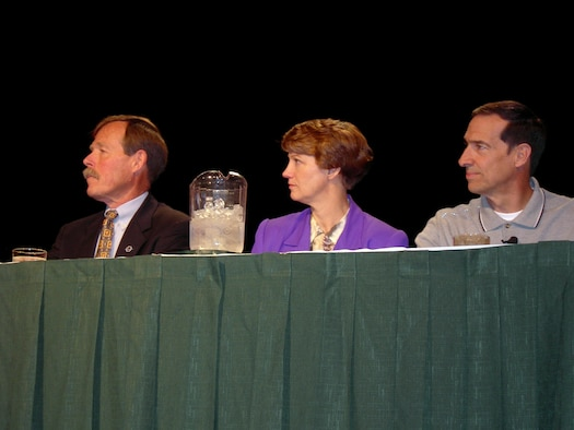 """Retired Air Force Col. Eileen Collins is flanked by Robert """"Hoot"""" Gibson, left, and Brian Binnie at the 17th International Women in Aviation Conference in Nashville, Tenn., on Saturday, March 25, 2006. (U.S. Air Force photo/Annette Crawford)"""