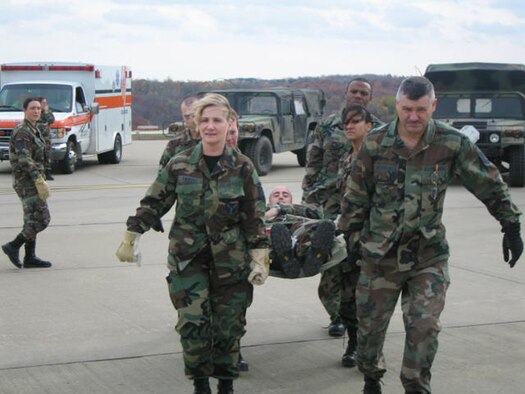 After transporting a patient to the flight line during Patriot Care 2006, litter carriers from the 911th Aeromedical Staging Squadron prepare to on-load a C-130 Hercules. Standing by in the aircraft were 911th Aeromedical Evacuation Squadron personnel tasked to take over the care of the incoming patients.