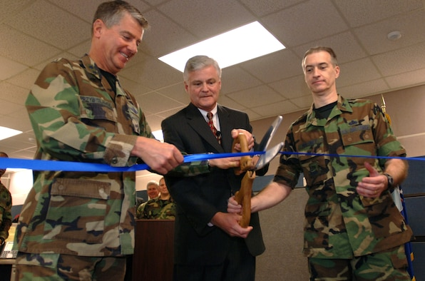 Left to right, Maj. Gen. Tony Przybyslawski, Air Force Personnel Center commander, Roger Blanchard, deputy A1, and Col. Michael Maloney, AFPC director of personnel, cut the ribbon to symbolize the operational beginning of the new Personnel Service Delivery System at Randolph Air Force Base, Texas, on Friday, March 31, 2006. (U.S. Air Force photo/Tech. Sgt. Cecilio Ricardo Jr.)