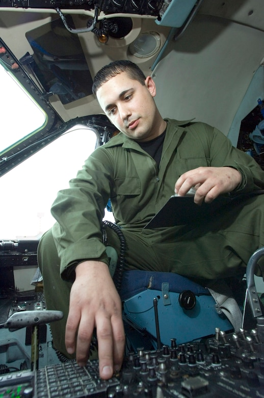 Senior Airman Aaron Ballegos runs a diagnostic check on the radio and navigation system on a C-5 Galaxy at Ramstein Air Base, Germany, on Thursday, March 30, 2006. Airman Ballegos, of Seattle, Wash., is a communications and navigations specialist with the 723rd Aircraft Maintenance Unit. (U.S. Air Force photo/Master Sgt. John E. Lasky)
