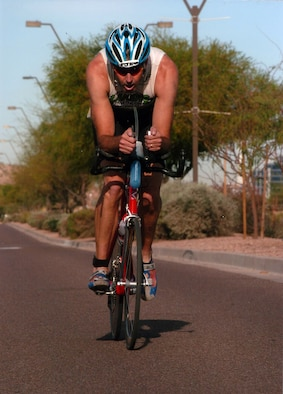 Lt. Col. Geoff Cleveland, 301st Fighter Squadron, rides his bike at the 2006 Ironman Triathlon in Tempe Town Center April 9. (Courtesy photo)