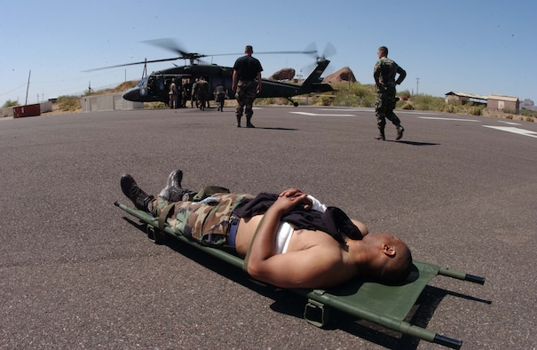 Senior Airman Anthony Carter, 944th Medical Squadron records administrator, awaits a medivac to the Maricopa County Burn Center during a disaster preparedness exercise April 26, 2006. Airman Carter was a simulated burn victim during the week-long exercise that involved active duty, Guard and Reserve units from across the United States and local community hospitals and businesses. (U.S. Air Force photo/Master Sgt. Garrett McClure)