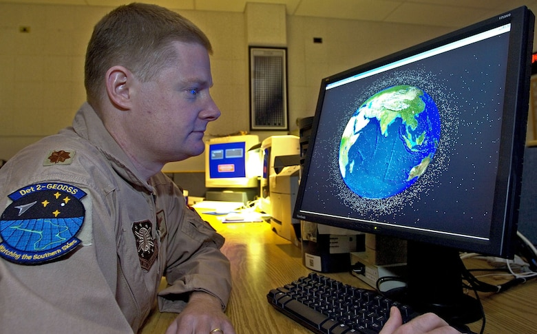 Maj. Jay Fulmer uses space and missile analysis software to track known man-made deep space objects in orbit around Earth. Major Fulmer is commander of Detachment 2 of the Ground-Based Electro-Optical Deep Space Surveillance System in Southwest Asia. (U.S. Air Force photo/Senior Master Sgt. John Rohrer)