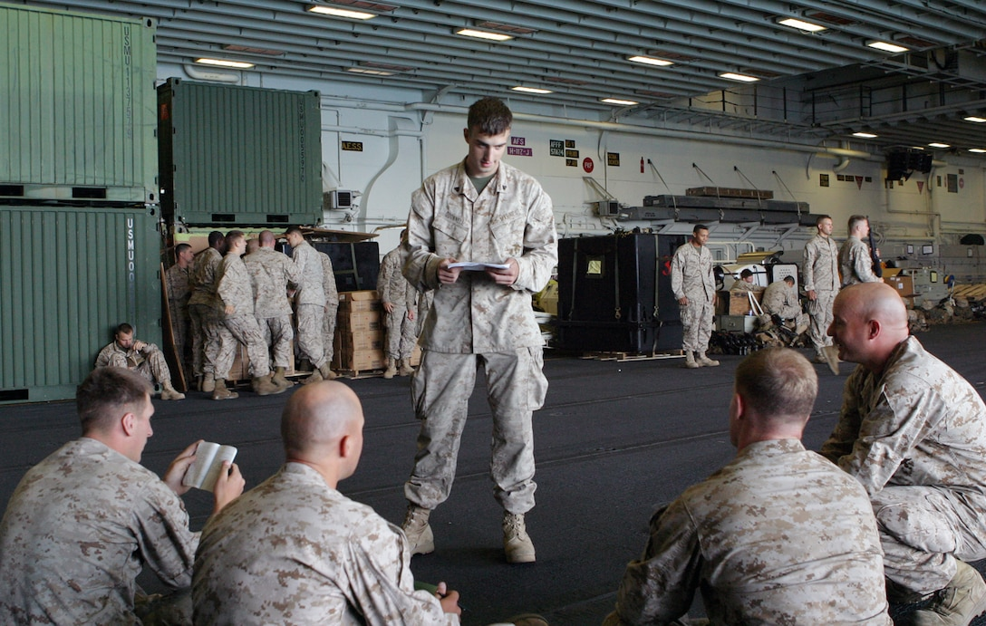 Cpl. Paul C. O'Donnell, an anti-tank guided missleman with Weapons Company, Battalion Landing Team, 1st Battalion, 8th Marine Regiment, 24th Marine Expeditionary Unit, teaches a class on Arabic language skills in the hangar bay of the USS Iwo Jima on May 3, 2006.  Currently, the 24th MEU is working toward earning its Special Operations Capable or SOC designation during its Certification Exercise.