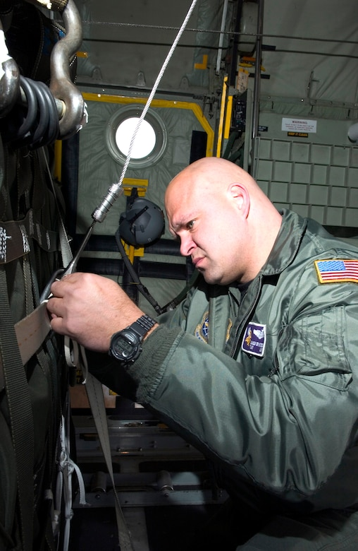 Tech. Sgt. Chuck Brynteson secures container delivery systems in a C-130 Hercules at Elmendorf Air Force Base, Alaska, as part of Red Flag-Alaska 06-2 exercises on Friday, April 28, 2006. Sergeant Brynteson is with the 96th Airlift Squadron at Minneapolis-St. Paul Joint Air Reserve Station, Minn. (U.S. Air Force photo/Senior Airman Garrett Hothan)