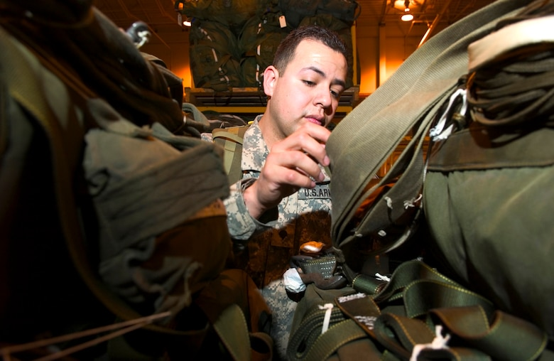 Army Spc. Salvador Garcia-Espinosa ensures that container delivery systems are secure and readied for transport at Elmendorf Air Force Base, Alaska, as part of Red Flag-Alaska 06-2 exercises on Friday, April 28, 2006. Specialist Garcia-Espinosa is with the 167th Support Battalion at Fort Richardson, Alaska. (U.S. Air Force photo/Senior Airman Garrett Hothan)