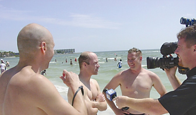 Doug Gale, of Beavercreek, Ohio,  Chris Zingarelli, of National Air and Space Intelligence Center, and Jay Wilkerson, of Air Force Institute of Technology, are interviewed by a local reporter here after setting a new relay record April 22 at the Tampa Bay Marathon Swim. (Air Force photo by Jack Bazure)