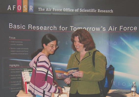 Dr. Kathleen Kaplan, Program Manager, External Programs & Resources Interface, Air Force Office of Scientific Research (AFOSR), discusses AFOSR's grant portfolio for graduate and post graduate students with a student attendee at the 44th National Junior Science and Humanities Symposium held April 26-29 in Albuquerque, N.M. (Air Force photo by Erin Crawley)