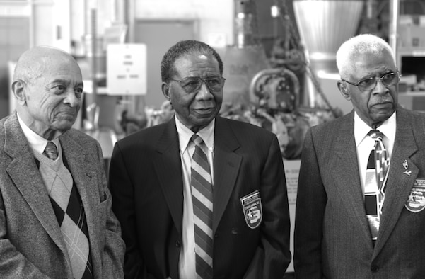 Tuskegee Airmen, retired Lt. Col. Harry Stewart, retired Master Sgt. Buford Johnson, and retired Lt. Col. James Harvey III, stand in the restoration hangar of the National Museum of the United States Air Force. The three spoke  about racial discrimination