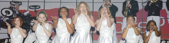 Members of the 2006 Tops in Blue entertain Sumter and Shaw members with song and dance Wednesday at Patriot Hall. (U.S. Air Force Photo/Tech. Sgt. Shirley Henderson)