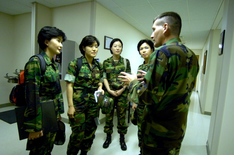 Lt. Col. David Beavers explains the operation of the William R. Schick Clinic to four visiting South Korean Air Force nurses at Hickam Air Force Base, Hawaii, on Tuesday, April 25, 2006. South Korea sent seven nurses to the island to discuss mass casualty response, civil-military coordination and biohazard response procedures for natural disaster management. The colonel is the chief nurse at the clinic and is assigned to the 15th Medical Group. (U.S. Air Force photo/Tech. Sgt. Shane A. Cuomo)