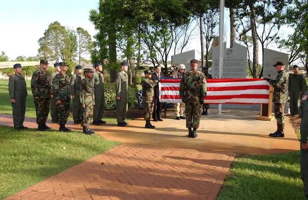 Airmen from the Hurlburt Field Honor guard prepare to retire the colors at a retreat ceremony April 28 in honor of those who lost their lives in Desert One while trying to rescue 52 American hostages in Iran 26 years ago.