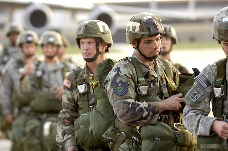 Tech. Sgt. Paul Schaaf waits to board a C-130 Hercules that will transport him to a drop zone at Pope Air Force Base, N.C., on Wednesday, April 25, 2006. Airmen and more than 2,000 Soldiers from the Army's 82nd Airborne Division were taking part in a Joint Forcible Entry Exercise. Sergeant Schaaf is assigned to the 820th Security Forces Squadron at Moody Air Force Base, Ga. Thirty other jump-qualified Air Force engineers, firefighters, and security forces Airmen assisted in security and rapid runway repair. (U.S. Air Force photo/Master Sgt. Scott Wagers)