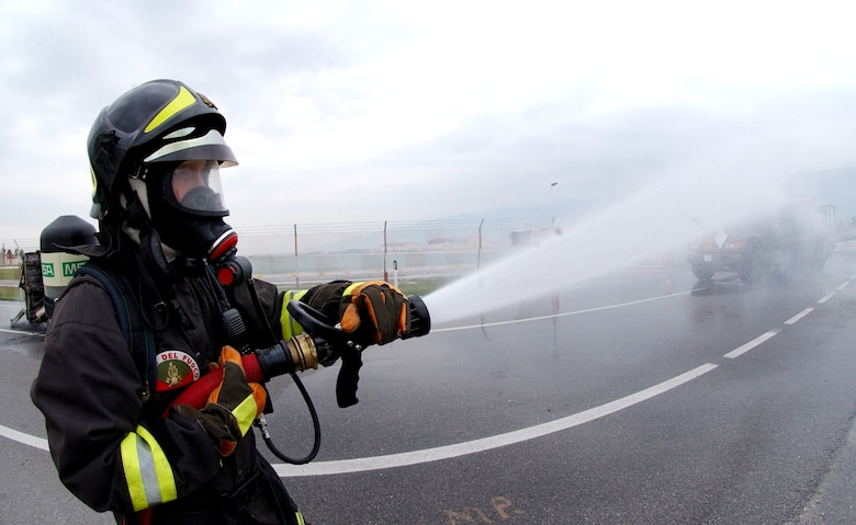A firefighter from the Vigili del Fuoco (Italian Fire Department) participates in an American-Italian exercise on Thursday, May 4, 2006. Responders from various Italian fire and police departments and medical facilities joined those from the 31st Fighter Wing fire department, hospital and security forces at Aviano Air Base, Italy, for a mass accident exercise. The purpose of the exercise is to develop a seamless response capability between Italian and American emergency professionals. (U.S. Air Force photo/Tech. Sgt. Charlein Sheets)