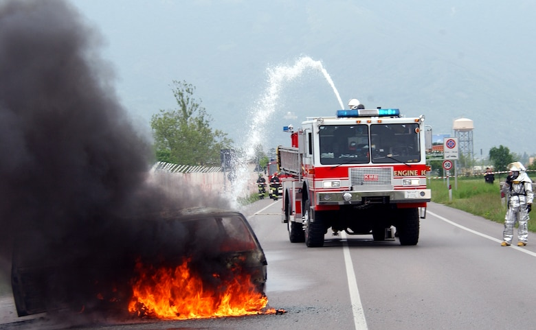 Firefighters from the 31st Fighter Wing at Aviano Air Base, Italy, douse a fire during an American-Italian exercise on Thursday, May 4, 2006. Responders from various Italian fire and police departments and medical facilities joined those from the 31st FW fire department, hospital and security forces for a mass accident exercise. The purpose of the exercise is to develop a seamless response capability between Italian and American emergency professionals. (U.S. Air Force photo/Tech. Sgt. Charlein Sheets)