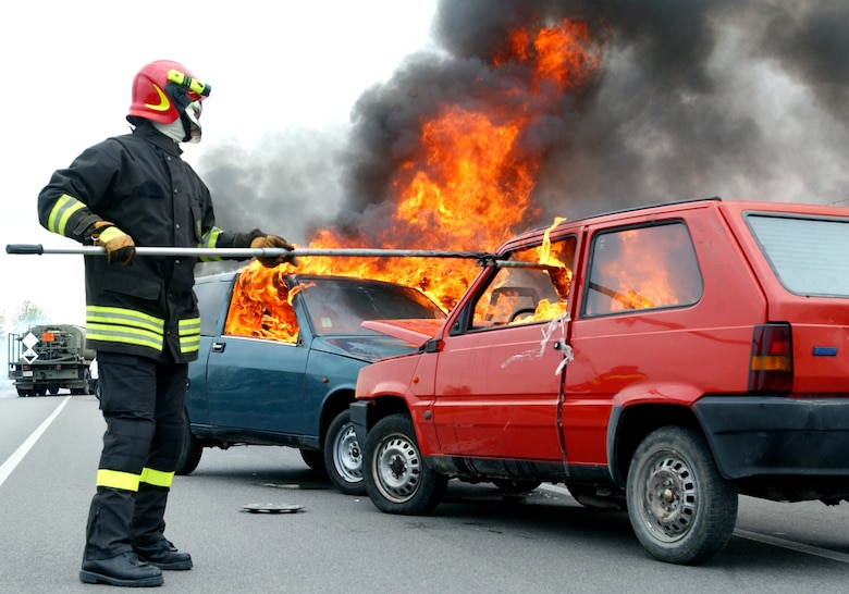An Italian fireman lights a car on fire for an American-Italian exercise on Thursday, May 4, 2006. Responders from various Italian fire and police departments and medical facilities joined those from the 31st Fighter Wing fire department, hospital and security forces at Aviano Air Base, Italy, for a mass accident exercise. The purpose of the exercise is to develop a seamless response capability between Italian and American emergency professionals. (U.S. Air Force photo/Tech. Sgt. Charlein Sheets)