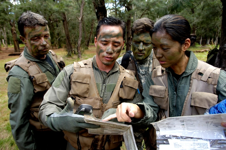 Students use a map and GPS (global positioning system) to find their location May 4, 2006 during a ground survival refresher course at Schofield Barracks training area, Hawaii. The course provides hands on realistic training for aircrew members that concentrates on the principles, techniques, and skills necessary to survive in any environment and return home. Staff Sgt. Ferguson is the SERE (survival, evasion resistance and escape) instructor from the 15th Operations Support Squadron. He is responsible for training all active duty and Air National Guard aircrews on Hickam. (U.S. Air Force photo/Tech. Sgt. Shane A. Cuomo)