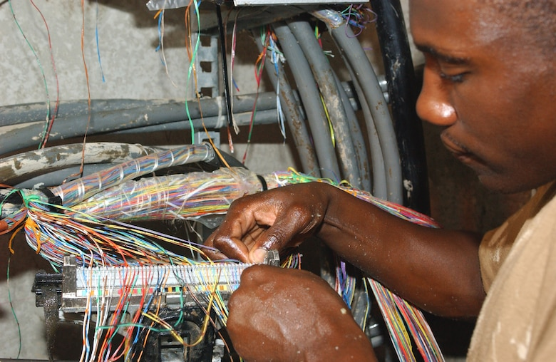 Connecting the world one wire at a time > U.S. Air Force > Article ...