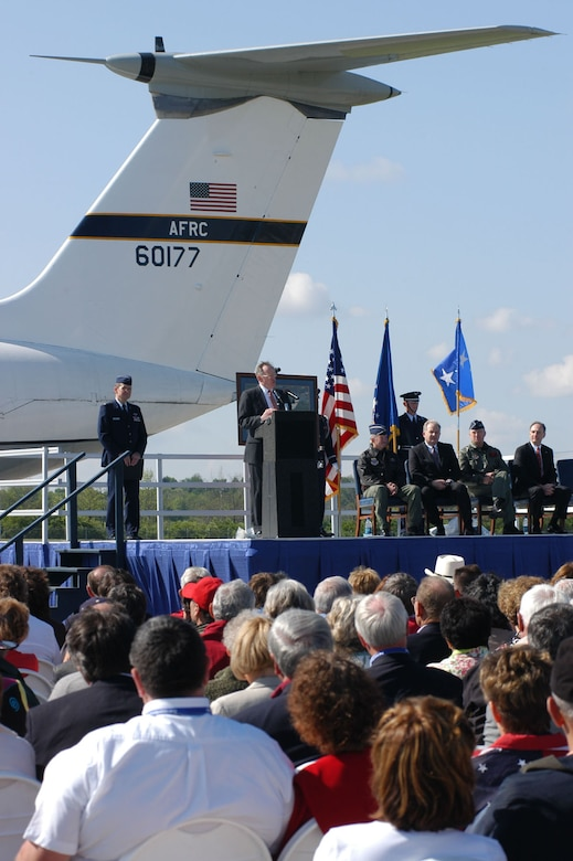 """DAYTON, Ohio (5/6/06) -- Maj. Gen. (Ret.) Charles Metcalf, director of the National Museum of the United States Air Force, addresses the audience after the C-141 """"Hanoi Taxi"""" made its final flight. Ceremony speakers included (from left to right) Gen. Duncan McNabb, commander of Air Mobility Command, Gen. (Ret.) William Begert, vice president of business development and international programs in the Military Engines unit at Pratt & Whitney, Lt. Gen. John Bradley, commander of Air Force Reserve Command, and Ross Reynolds, vice president of air mobility programs at Lockheed Martin. (U.S. Air Force photo by Jeff Fisher)"""