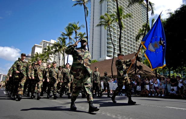 """Airmen from Hickam Air Force Base, Hawaii, march past the review stand during the """"Salute to our Troops"""" parade in downtown Honolulu on Saturday, May 6, 2006. The USO hosted the parade which included active-duty, Guard and Reserve members of all the services. (U.S. Air Force photo/Tech. Sgt. Shane A. Cuomo)"""