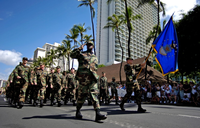 "Airmen from Hickam Air Force Base, Hawaii, march past the review stand during the ""Salute to our Troops"" parade in downtown Honolulu on Saturday, May 6, 2006. The USO hosted the parade which included active-duty, Guard and Reserve members of all the services. (U.S. Air Force photo/Tech. Sgt. Shane A. Cuomo)"