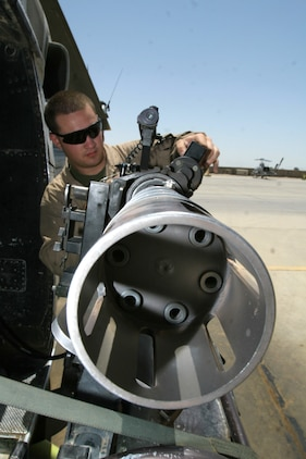 Lance Cpl. Justin W. Ahlers inspects a GAU-17/A Gatlin gun on a UH-1N Huey before a dismounted patrol escort flight May 11. Ahlers is a crew chief and Jefferson, Wis., native deployed with Marine Light Attack Helicopter Squadron 169, Marine Aircraft Group 16 (Reinforced), 3rd Marine Aircraft Wing.