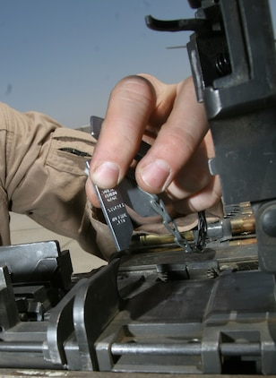 A Marine crew chief checks the timing and spacing on an M2 .50-caliber machine gun on a UH-1N Huey before a dismounted patrol escort flight May 11. Ahlers is a crew chief and Jefferson, Wis., native deployed with Marine Light Attack Helicopter Squadron 169, Marine Aircraft Group 16 (Reinforced), 3rd Marine Aircraft Wing.