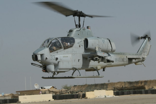 An AH-1W Super Cobra helicopter taxis toward the flight line at Al Taqaddum, Iraq, May 11. The aircraft belongs to Marine Light Attack Helicopter Squadron 169, Marine Aircraft Group 16 (Reinforced), 3rd Marine Aircraft Wing.