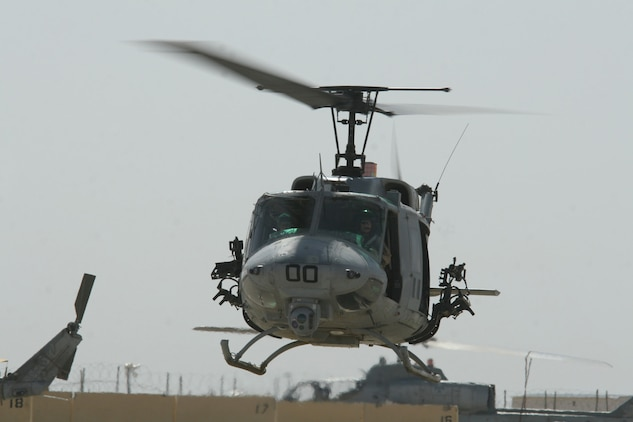 A UH-1N Huey helicopter taxis toward the flight line at Al Taqaddum, Iraq, May 11. The Cobra belongs to Marine Light Attack Helicopter Squadron 169, Marine Aircraft Group 16 (Reinforced), 3rd Marine Aircraft Wing. The squadron escorted a dismounted convoy through the streets and fields of Karma that afternoon.