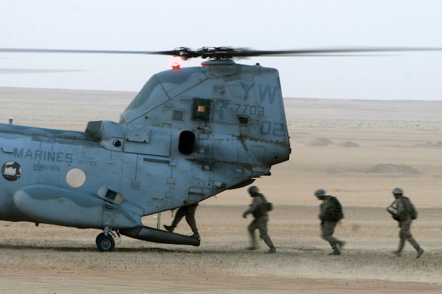 -- Marines with Golf Company, Battalion Landing Team 2/5, 15th Marine Expeditionary Unit load on to a CH-46E Sea Knight from Marine Medium Helicopter Squadron-165, 15th MEU outside Camp Buehring, Kuwait. ::r::::n::   The Camp Pendleton, Calif. based 15th