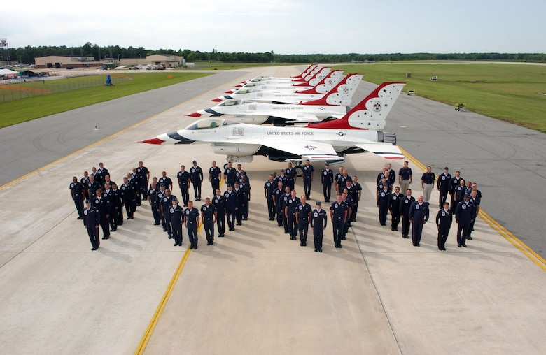 Airmen from the United States Air Force Air Demonstration Squadron, the Thunderbirds, line up to form the number 4,000 to commemorate the team's milestone air show on Saturday, May 13, 2006. (U.S. Air Force photo)