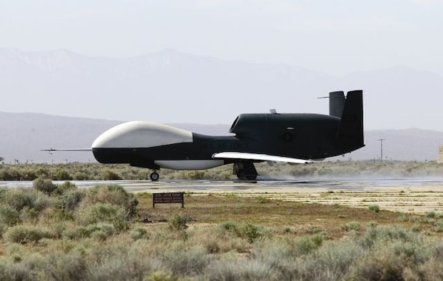 EDWARDS AIR FORCE BASE, Calif. - A Global Hawk unmanned aerial vehicle performs a high-speed taxi test on South Base here during Phase III of wet runway testing May 3. This is the first time wet runway tests have been conducted with a UAV. (Air Force photo by Bobbi Zapka)