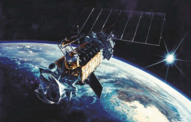 An artist's rendition of a DMSP satellite orbiting Earth.